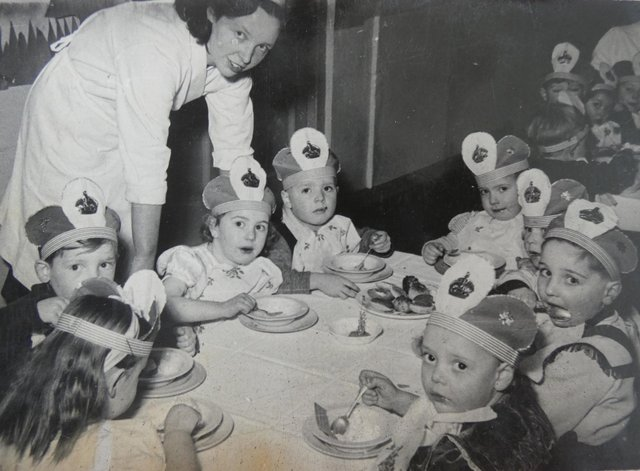 Children at what appears to be a coronation celebration party