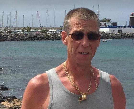 Karl Drabble wearing the gold chains which were ripped from his neck at Heeley Retail Park