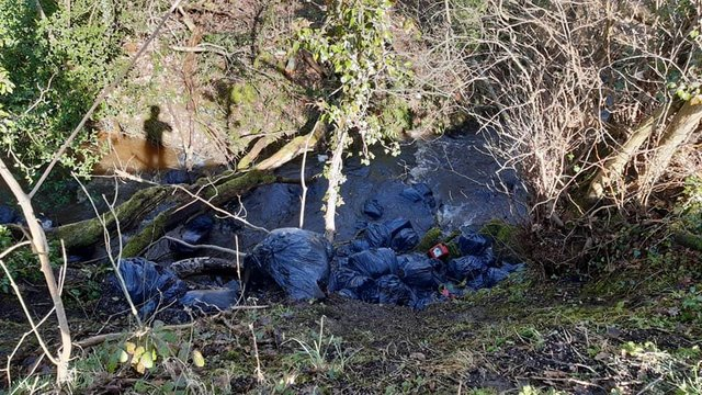 Flytipping beside the River Porter in Sheffield's Mayfield Valley