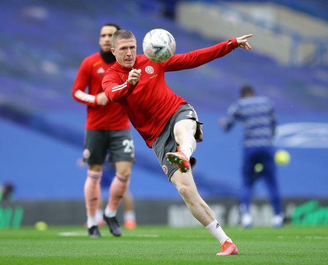 John Lundstram warms up before Sheffield United's visit to Chelsea in the FA Cup: David Klein/Sportimage