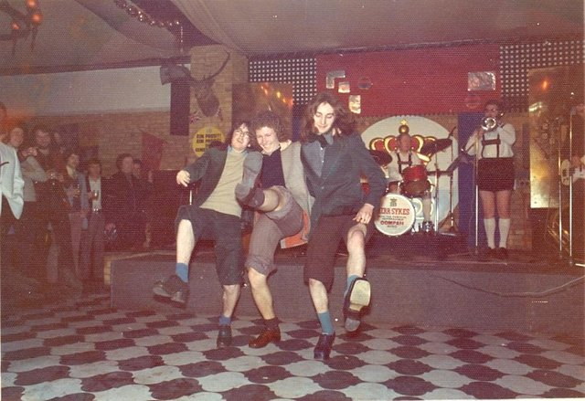 Three lads here giving it a go on the dancefloor at the Hofbrauhaus to the unmistakable sound of the oompah band