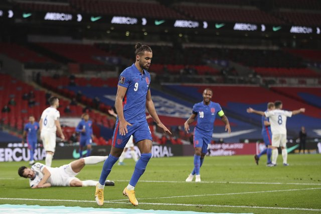 England's Dominic Calvert-Lewin celebrates after scoring his side's opening goal during the World Cup 2022 group I qualifying match between England and San Marino at Wembley stadium. (Carl Recine/Pool Photo via AP)