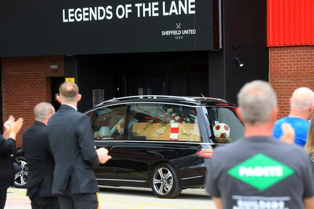 The funeral of former Sheffield United captain Len Badger passes Bramall Lane.  Picture: Chris Etchells