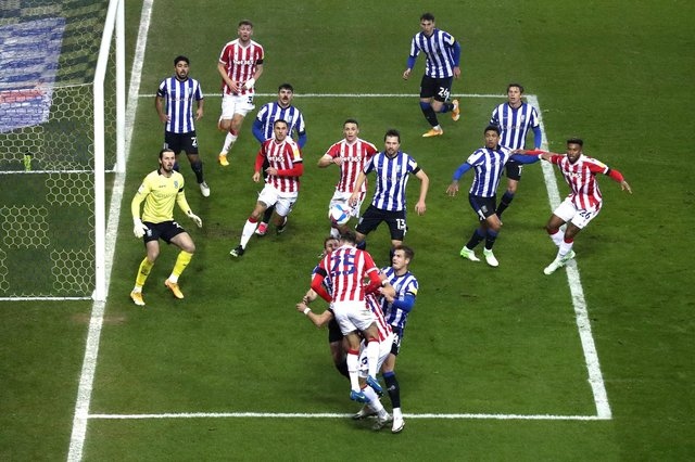 SHEFFIELD, ENGLAND - NOVEMBER 28: Nick Powell of Stoke City wins a header as both sides compete for the ball during the Sky Bet Championship match between Sheffield Wednesday and Stoke City at Hillsborough Stadium on November 28, 2020 in Sheffield, England. Sporting stadiums around the UK remain under strict restrictions due to the Coronavirus Pandemic as Government social distancing laws prohibit fans inside venues resulting in games being played behind closed doors. (Photo by George Wood/Getty Images)