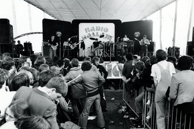 UB40 performing at a Radio Hallam Roadshow in the early 1980s - some fascinating fashions on display in the crowd! Ref no U05987
