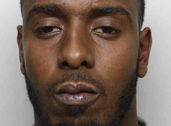 Abdi Ali, from Sheffield, is wanted for questioning over a murder