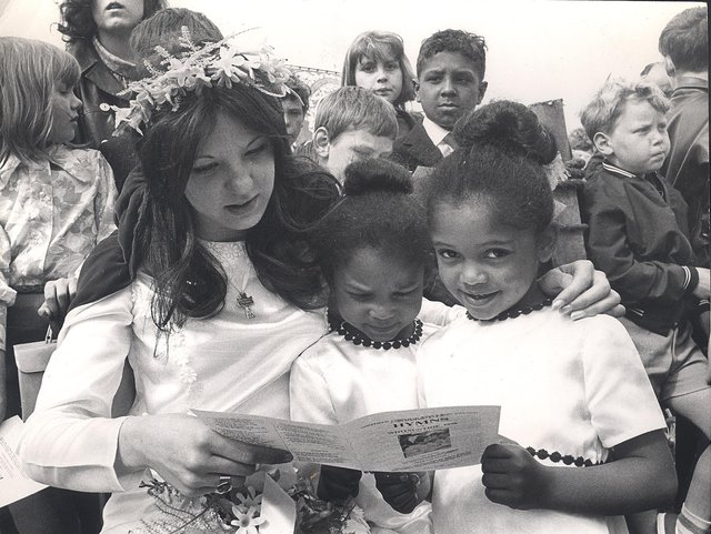 Sue Tomlinson (now Pearson), the Ebenezer Wesleyan Reform Church,Bramall Lane Sunday School May Queen with Evelyn and Sharron Thomas, her train-bearers, singing hymns at Meersbrook Park on May 25, 1970