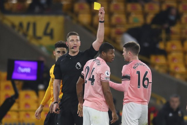 Sheffield United's Rhian Brewster is shown a yellow card at Wolves. (Catherine Ivill/Pool via AP)
