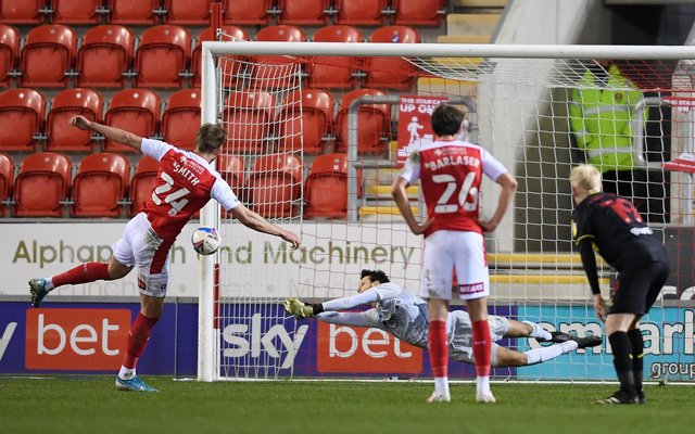 Daniel Bachmann of Watford saves a penalty from Michael Smith of Rotherham United.