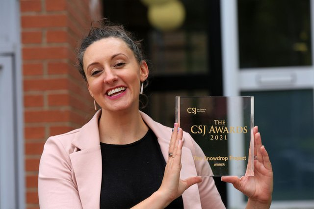 Lara Bundock, founder and director of Snowdrop Project, pictured with the award. Picture: Chris Etchells