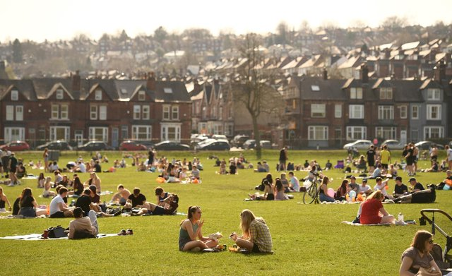 People enjoying the sunshine in Endcliffe Park in Sheffield, earlier this week as England's third Covid-19 lockdown restrictions eased at the start of the week, allowing groups of up to six people to meet outside. (Photo by OLI SCARFF/AFP via Getty Images)