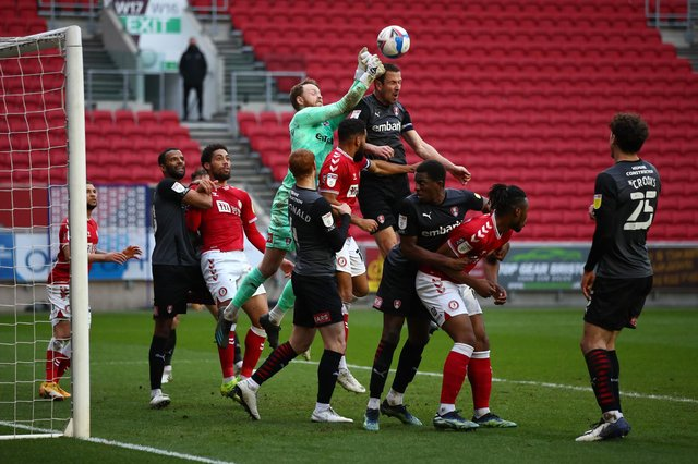 Viktor Johansson of Rotherham United punches the ball clear under pressure during the Sky Bet Championship match between Bristol City and Rotherham United.