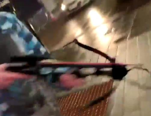 A man brandishes a crossbow in Barnsley town centre in this still from a video shared by Euan Moxon