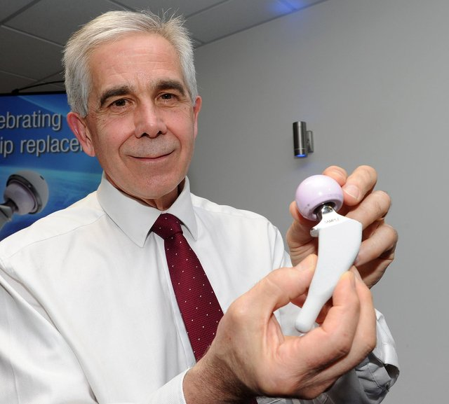 Jerry Agass, joint managing director at JRI Orthopaedics with a hip replacement implant.