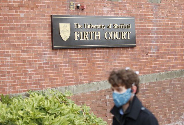 A man, wearing a face covering, walks past The University of Sheffield's Firth Court. Picture used for illustrative purposes only. PA Photo: Danny Lawson/PA Wire