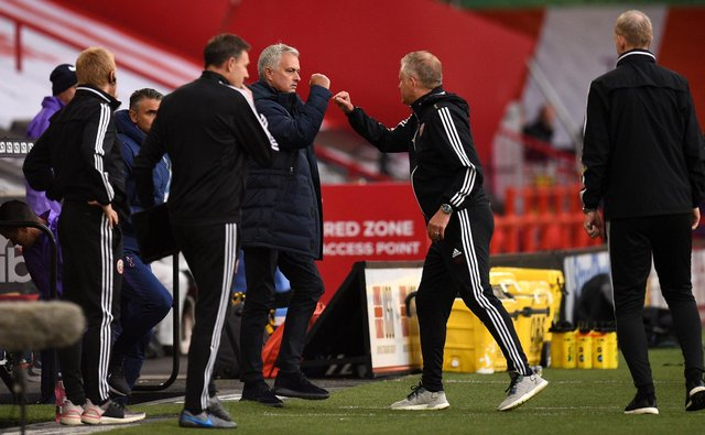 The drinks are on Chris Wilder as Sander Berge and Sheffield United smashed Jose Mourinho's Tottenham. Here is an image of them bumping fists.
