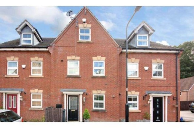 The Town House in Northwood Place has three bedrooms and two bathrooms