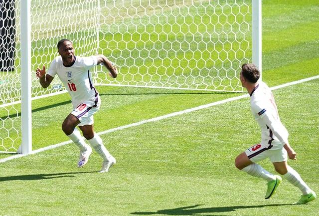 England's Raheem Sterling (left) celebrates scoring with team-mate Mason Mount.