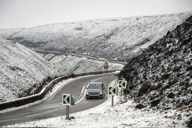 A car navigates the Snake Pass in Derbyshire, as a blast of snow hits the north of England. Photo: Danny Lawson/PA Wire