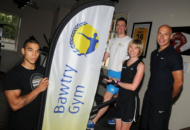 (l-r) Personal trainer Colin Bower, owner Luke Walker, personal trainer Alicia Kaill, all of Bawtry Gym, with referee Howard Webb MBE, at the opening of Bawtry Gym. Picture: Andrew Roe