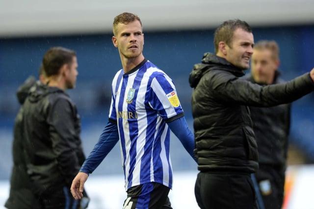Sheffield Wednesday's Dutch defender Joost van Aken has joined Zulte-Waragem.