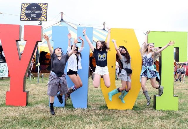 Y Not Festival 2014 - Ashbourne lasses Fran Carvey, Jess Shearar, Lizzie Scattergood-Farmer, Georgia Roberts and Millie Ward jumping for joy