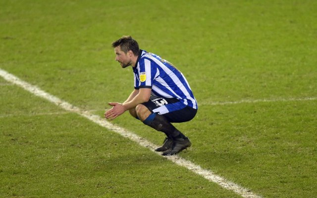 A dejected Julian Borner sinks to his knees after Sheffield Wednesday's 2-1 defeat to Rotherham United at Hillsborough on Wednesday night. Photo: Steve Ellis.