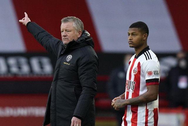 Chris Wilder with Rhian Brewster of Sheffield United: Andrew Yates/Sportimage