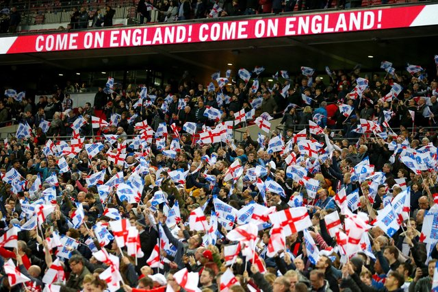 File photo dated 22-03-2019 of England fans in the stands at Wembley Stadium. Issue date: Monday July 5, 2021. PA Photo. Sports venues in England are set to return to full capacity from July 19 after the Government announced plans to ease the remaining restrictions on social distancing. See PA story SPORT Fans. Photo credit should read Steven Paston/PA Wire.