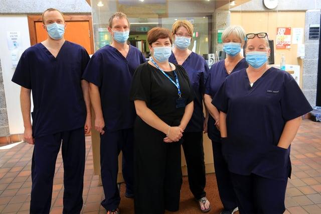 Dr Ben Allen and staff at Birley Health Centre. Picture: Chris Etchells