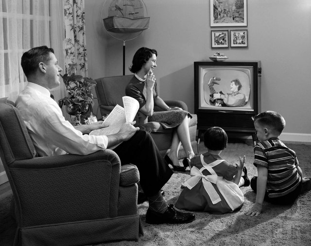 watching telly -  old fashion family watching television set tv t.v  / 1950s / historical / children / home / lounge /