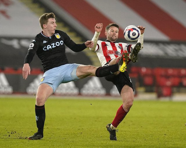 Oliver Norwood of Sheffield United tussles with Matt Targett of Aston Villa: Andrew Yates/Sportimage