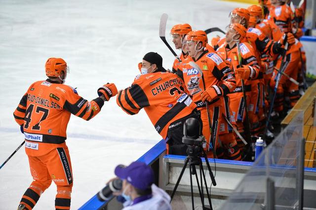 Adrian Saxrud-Danielsen celebrates with the bench. Photo: Dean Woolley