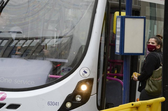 Public transport users in South Yorkshire wearing masks as they travel by bus.
