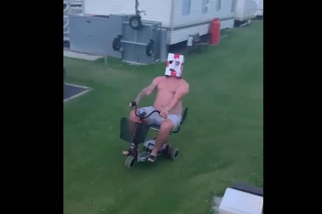 Curtiss Sargeant performs a wheely on the scooter to celebrate England beating Ukraine last night