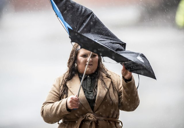 A fan arrives in the heavy rain for the Premier League match at Bramall Lane between Sheffield United and AFC Bournemouth as Storm Ciara hit the UK on Sunday, February 9, 2020