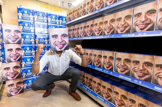 Jag Singh at his Go Local Extra store on Shoreham Street, which has been transformed into a Kyle Walker shrine with the help of Bud Light (Photo: Fabio De Paola / PA Wire)