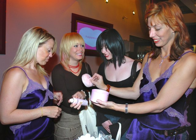 Pictured at the Takapuna Bar,West Street in 2005 were Julie Gash (right) and Clare Norris (left) of Gash showing Laura Middleton & Sarah Pickering the new range of cosmetics