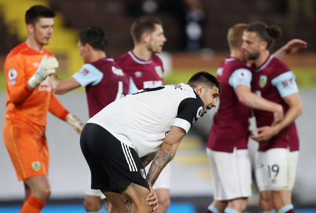 Aleksandar Mitrovic of Fulham looks dejected after defeat as Fulham are relegated following the Premier League match between Fulham and Burnley at Craven Cottage: Clive Rose/Getty Images