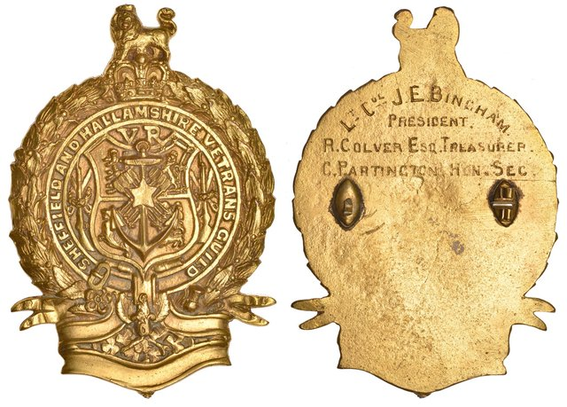 Badges, Military: Sheffield & Hallamshire Veterans Guild, brass, named (Lt. Col. J.E. Bingham, President, R. Colver, Esq, Treasurer, C. Partington, Hon. Sec.), 75 x 53mm. Pin for suspension detached, otherwise very fine and very rare £60-£80. The Sheffield & Hallamshire Veterans Guild was established in 1892 as a result of public outcry up and down the country at the way soldiers who had served in the Crimea and the Indian Mutiny were treated. Many had taken to begging on the streets and there were calls in Parliament for pensions to be raised. In Sheffield the Guild, known by its full title as the Sheffield and Rotherham Crimean and Indian Veterans' Relief Association, was founded by Sir John Edward Bingham, Bt (1839-1915), a master cutler, head of the firm of Walker & Hall and living in Upper Hallam, and a public subscription was set up to raise funds to supplement soldiers' annual pensions. Early in its existence it was supporting some 130 pensioners, but by the time of the 1901 annual dinner numbers had dropped to 53. The Guild was wound up after World War I.  Dix, Noonan, Webb