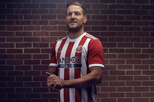 Billy Sharp models the new Sheffield United home shirt (Sheffield United)