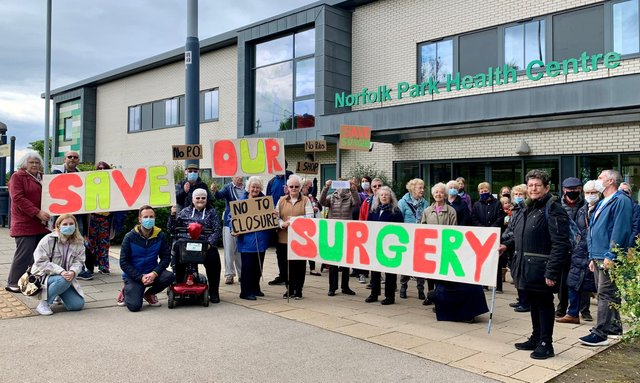 Residents outside the surgery.