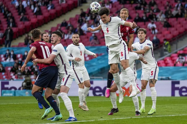 England's Harry Maguire heads the ball during the Euro 2020 soccer championship group D match between Czech Republic and England at Wembley. (AP Photo/Frank Augstein, Pool)