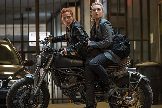 Scarlett Johansson as Black Widow/Natasha Romanoff and Florence Pugh as Yelena in Marvel Studios' BLACK WIDOW. Photo by Jay Maidment. ©Marvel Studios 2020.