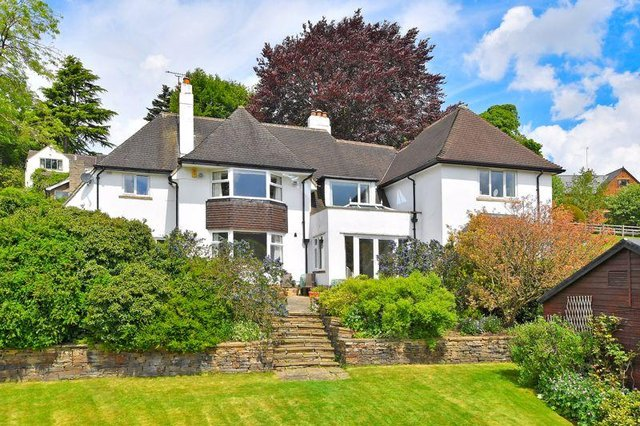The stunning six bedroom detached home stands in more than 2.5 acres of land overlooking the Mayfield Valley. It has an equestrian facility and annexe.