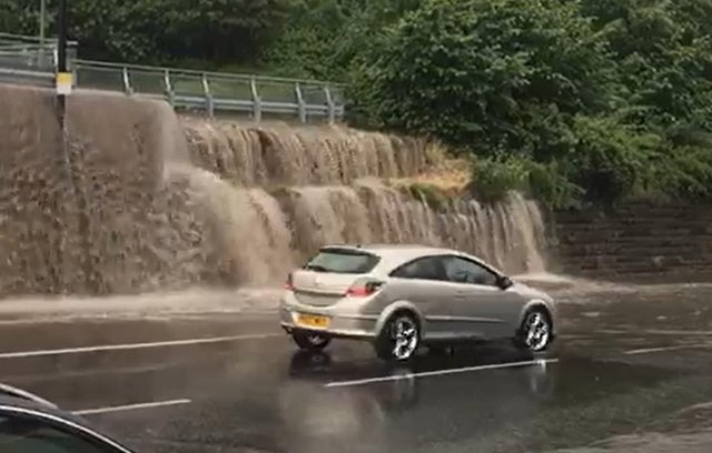 Dramatic footage taken by Ian Parkinson shows rainwater streaming out a nearby car park and onto Chesterfield Road.