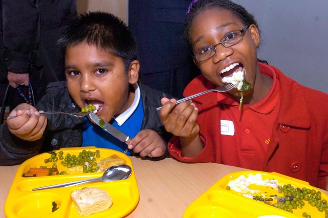 Mohamed Hasam and Sarah Zintchem, from Springfield school, tucking into their school dinners in 2011