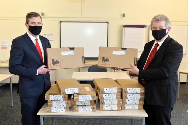 Schools collected laptops from Rockingham Professional Development Centre. Pictured are David Naisbitt, CEO of Inspire trust and Cllr Gordan Watson, deputy leader of the council and cabinet member for children's services & neighbourhood working.