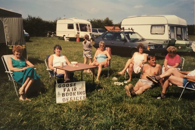 Barbara Betts taking trip bookings with friends at a Camping & Caravanning Club South Yorkshire District Association rally at Ingbirchworth Farm in 1986