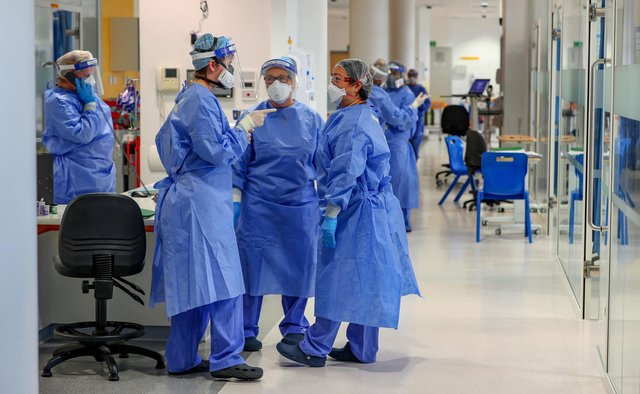Health workers wearing full personal protective equipment (PPE) on the intensive care unit (ICU) - PA